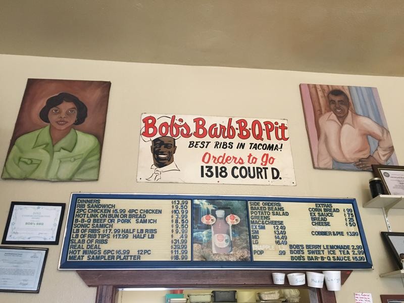 Paintings of Elizabeth and Robert Littles, who opened the original Bob's Bar-B-Q Pit in 1948, hang over the counter