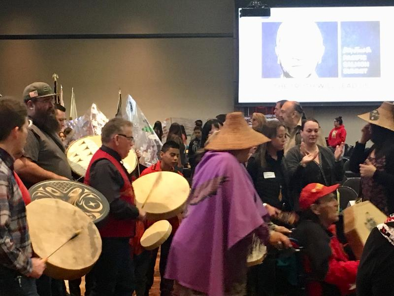 Ceremonial chanting and drumming set the tone for the meeting.