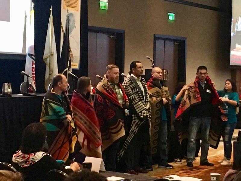 "A ceremonial call for official ""witnesses"" of the meeting included wrapping the individuals in woolen blankets. They were charged with paying close attention, to preserve memories of the summit meeting for the historical record."