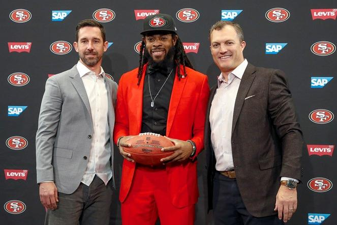 San Francisco 49ers head coach Kyle Shanahan, left, cornerback Richard Sherman, center, and general manager John Lynch, right, pose for a photo on March 20, 2018. Sherman agreed to a three-year deal with the 49ers.