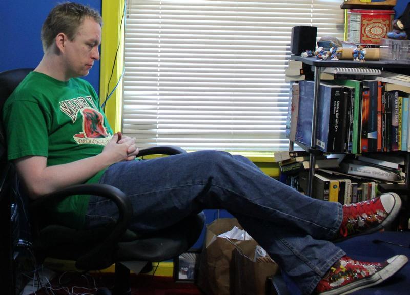 "Elliot Cossum relaxes in his ""office."""