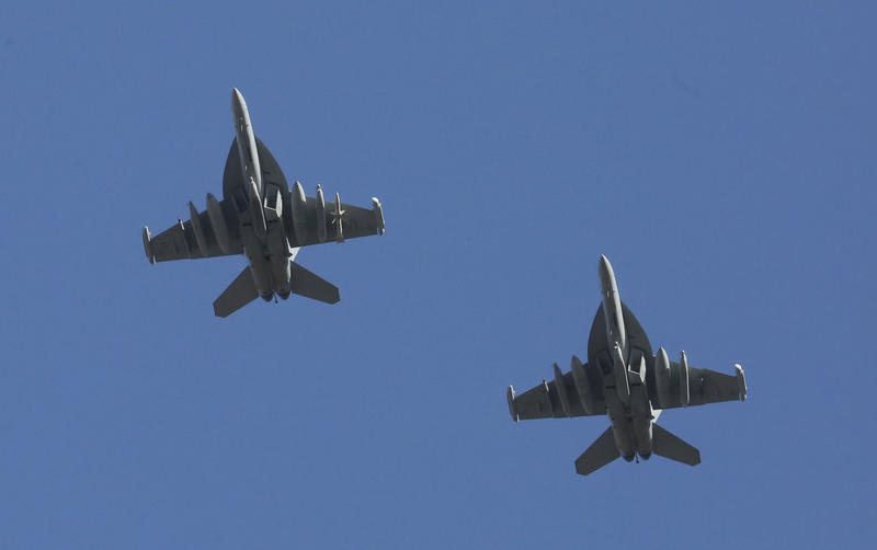 Navy EA-18G Growlers fly overhead before the start of the game between the New Orleans Saints and the Seattle Seahawks in the first half of an NFL NFC wild card playoff football game, Saturday, Jan. 8, 2011, in Seattle.