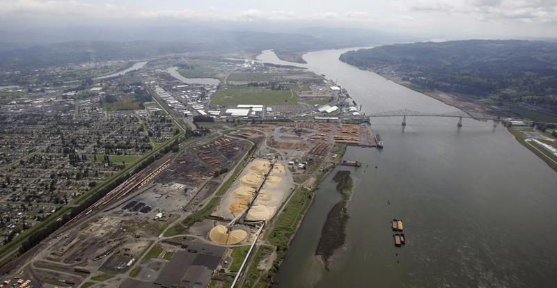 In this May 12, 2005, file photo, the Port of Longview is visible on the Columbia River at Longview, Wash., the site of Millennium Bulk Terminals' proposed coal facility, which would handle up to 44 million tons of coal a year, arriving by train.