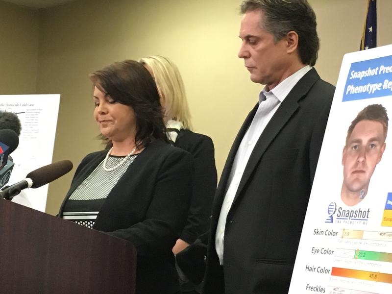 Laura Baanstra, with husband Gary, speaks at Snohomish County press conference where composite sketches of the suspect in the murder of her brother, Jay Cook, were released.