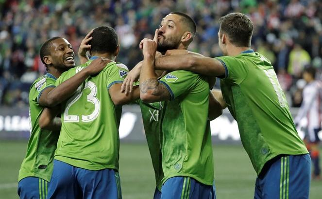 Sounders forward Clint Dempsey tries to silence opposing supporters after he scored a goal against Guadalajara during the second half of a CONCACAF Champions League soccer match, March 7, 2018, in Seattle. The Sounders won 1-0.