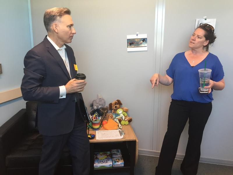 King County Executive Dow Constantine speaks with Sarah Burdell, who provides counseling to students at Highland Middle School