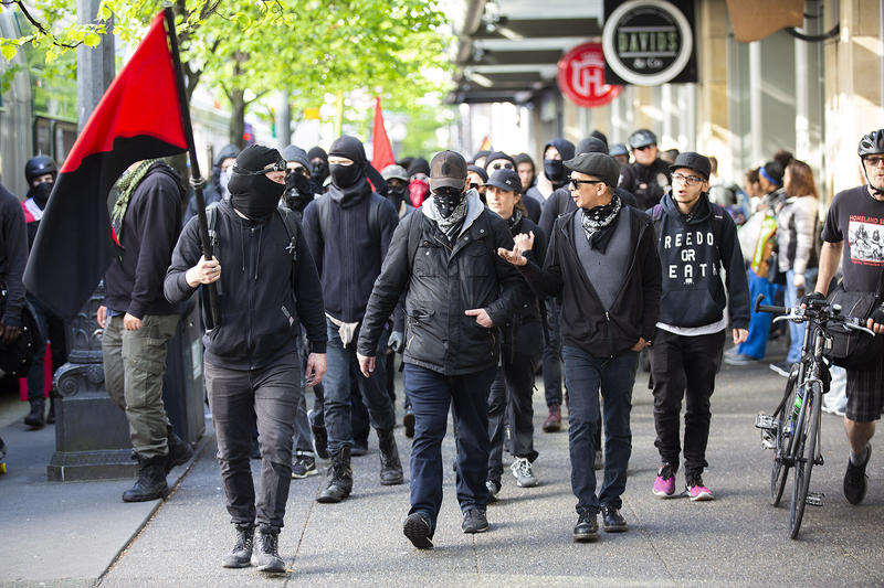 Antifa demonstrators broke away from the March for Immigration and Workers Right and took police throughout downtown eventually ending up in Capitol Hill.