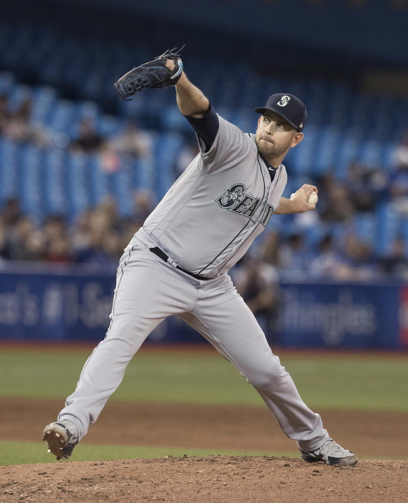 Pitcher James Paxton throws to a Toronto Blue Jays batter in Tuesday's game