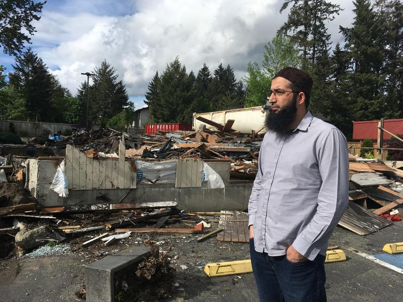 Omer Lone, an elder at the Islamic Center of Eastside surveys the burned-out ruins of the Bellevue mosque. It has been more than a year since the mosque's second arson.