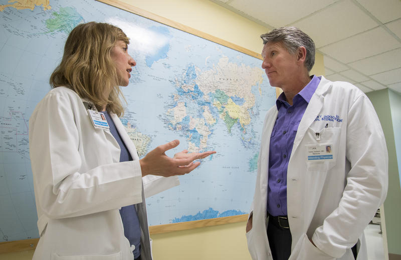 Dr. Alex Molnar, an attending physician, and Dr. Carey Jackson, the long time director of the International Medicine Clinic.