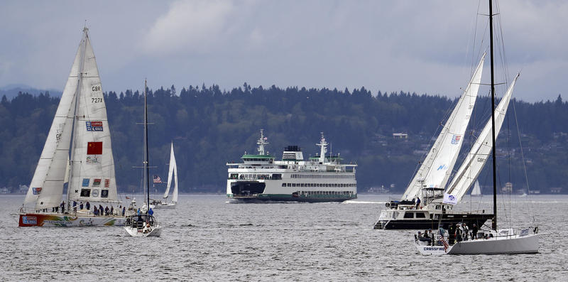 Sailboats in the Clipper Round the World Yacht Race and other vessels sail in view of a Washington state ferry during a two-lap, short course race in Elliott Bay Sunday, April 29, 2018, in Seattle.