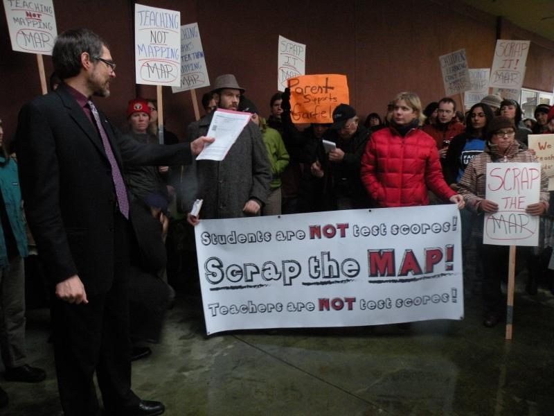 File photo: Teachers and their backers rallied outside district headquarters before a school board meeting in January 2013.