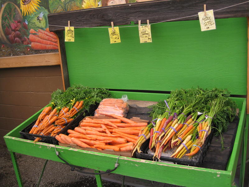 Nash Huber is known for tasty carrots. At this time of year, his farm stand store carries many grown on others' land.