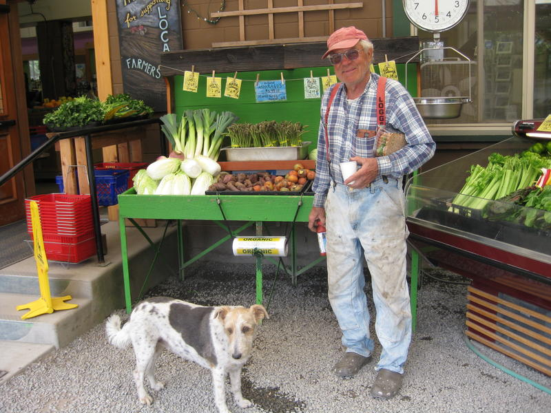 Nash Huber, with his dog Prancer, a Northwest farm terrier, at his Farm Store grocery market in Sequim.