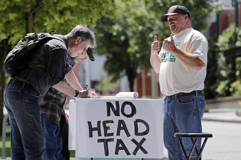 John Ellard, a paid signature gatherer, collects signatures for referendum to overturn head tax. Now, Seattle City Council may repeal the tax.