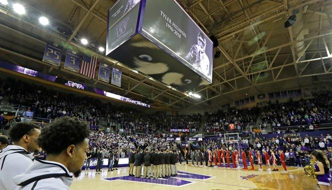 Washington and Washington State players and coaches join in a moment of silence, Sunday, Jan. 28, 2018, before an NCAA college basketball game in Seattle, in memory of WSU football quarterback Tyler Hilinski.