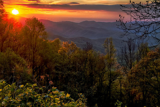 The views near Asheville, N.C., from the Blue Ridge Parkway, are beautiful, especially in the fall, and seeing them from a bicycle is sublime, says former bike tour guide Lynn DiBenedetto.