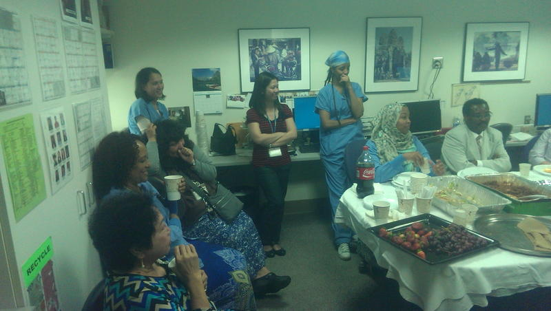 Some of the staff of Harborview's International Medicine Clinic. The staff tries to eat a meal together at least once a month.