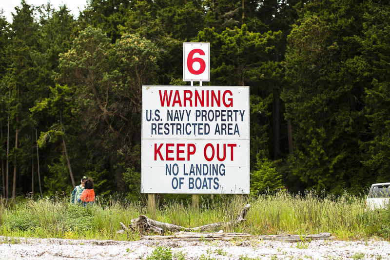 Signs dot the beaches of Indian Island