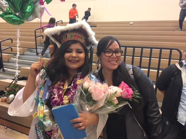 Erika Ann Ramirez (left) and Kateri Joe, her education specialist from the nonprofit group Treehouse, at her graduation from Muckleshoot Tribal School