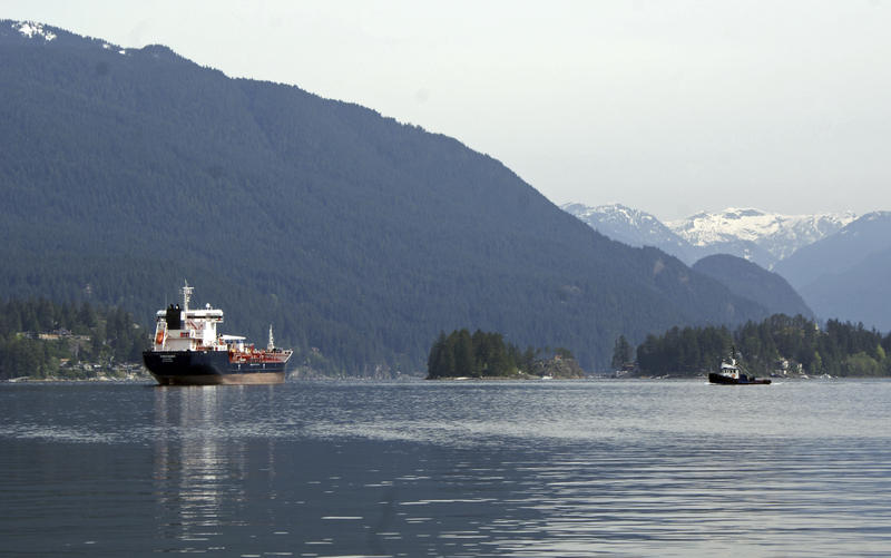 This May 3, 2018 photo shows the Kirkeholmen oil tanker anchored outside the Kinder Morgan Inc. Westridge oil terminal in Vancouver, Canada, at the end of the Trans Mountain pipeline that begins in northern Alberta and is set for controversial expansion.