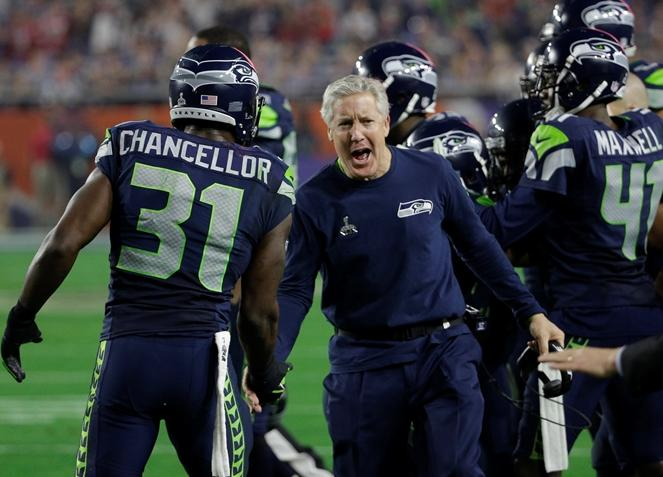 Seahawks head coach Pete Carroll celebrates with strong safety Kam Chancellor (31) after an interception during the second half of NFL Super Bowl XLIX football game against the New England Patriots Sunday, Feb. 1, 2015, in Glendale, Ariz.