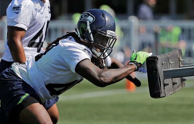 Seahawks linebacker Shaquem Griffin, one of the new faces on the team this season, hits a blocking sled during NFL football training camp, Thursday, July 26, 2018, in Renton.