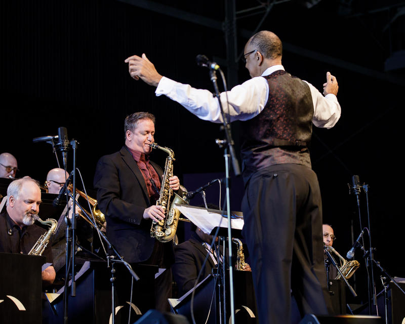 Mark Taylor solos on alto sax, John Clayton conducting