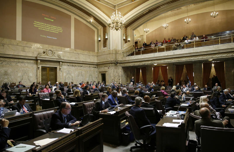 File photo: Representatives worked on the House floor during discussion of a bill to fully fund education in Washington state at the Capitol Friday, June 30, 2017, in Olympia