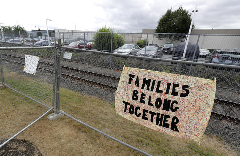 A sign seen on a fence outside the Northwest Detention Center on July 10, 2018