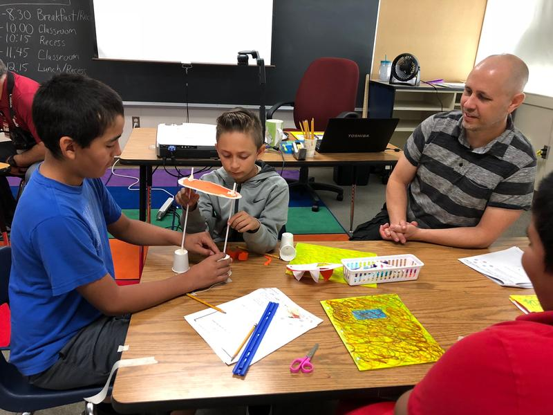 Teacher Brian Bartel (right) led a summer-school class for the children of migrant workers in the agriculture and fishing industries in Centralia. His class focused on the mechanics of flight.