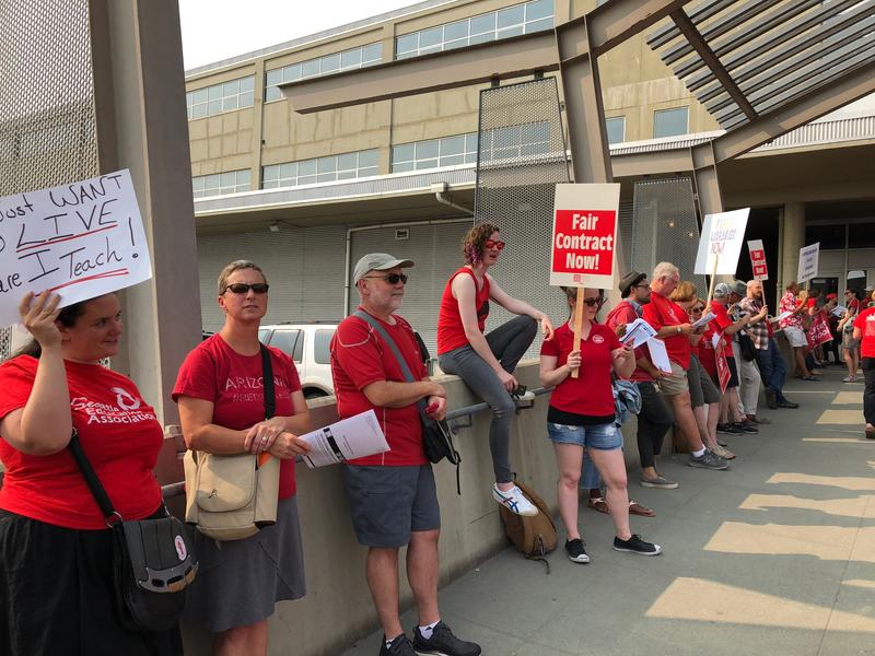 Seattle teachers rallied outside the school district headquarters earlier this month. Many said their compensation hasn't kept up with the rising cost of living in Seattle.
