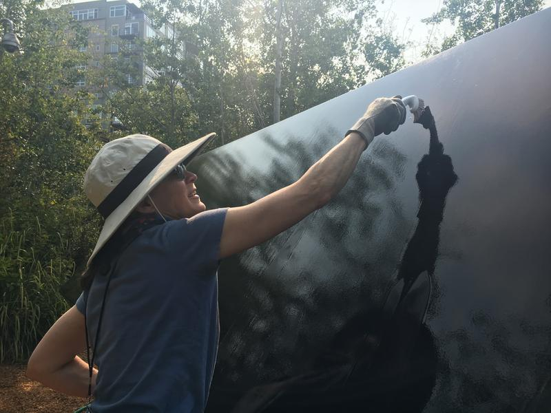 "Seattle Art Museum's associate collections care manager Monica Cavagnaro scrubs ""Stinger"" with a non-toxic cleaning solution to remove bird droppings."