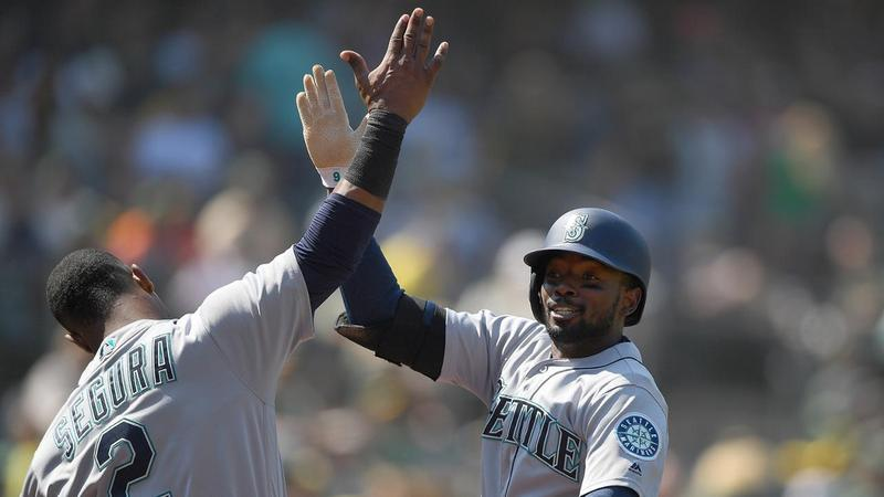 Dee Gordon celebrates after providing the game-winning two-run homer in the 12th inning against the Athletics on Wed., Aug. 15.