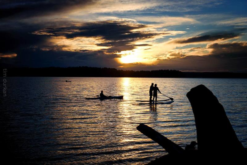 Standup paddleboarders enjoying a sunset in Seattle, November 2015.