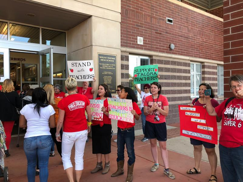 Supporters greeted Tacoma teachers as they gathered for a strike authorization vote Tuesday evening.