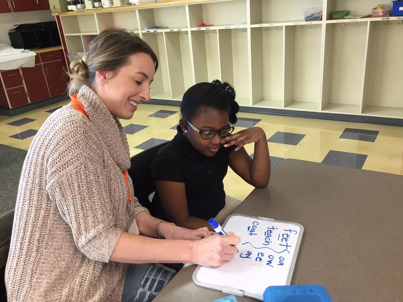 Amy Bice, a volunteer with Reading Partners, works with Senai Sampson at Madrona Elementary School
