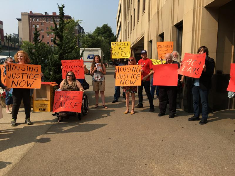 Activists demand help for displaced tenants outside Tacoma City Hall on Aug. 14, 2018