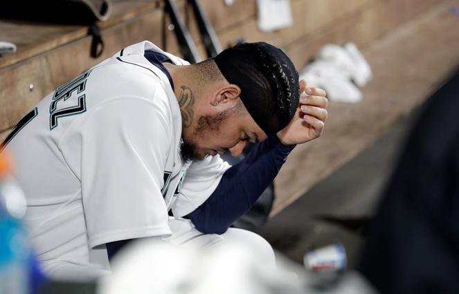 Mariners starting pitcher Felix Hernandez sits in the dugout after being relieved against the Oakland Athletics in a baseball game Wednesday, Sept. 26, 2018, in Seattle.