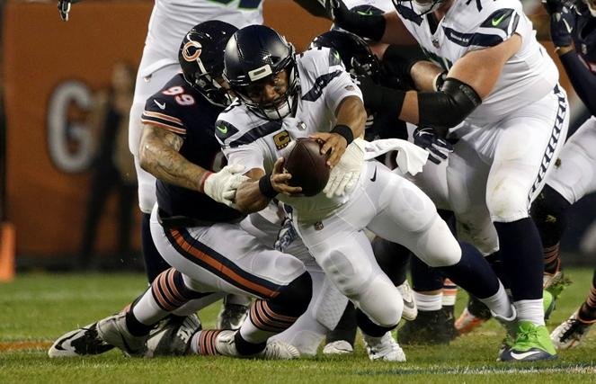 Chicago Bears linebacker Aaron Lynch (99) sacks Seahawks quarterback Russell Wilson (3) during the first half of the NFL's Monday Night Football game, Sept. 17, 2018, in Chicago.