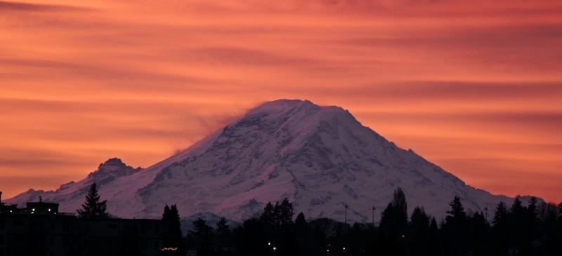 Mount Rainer is seen at dawn in this Jan. 2, 2012, file photo, from Seattle, some 50 miles away from the national park.