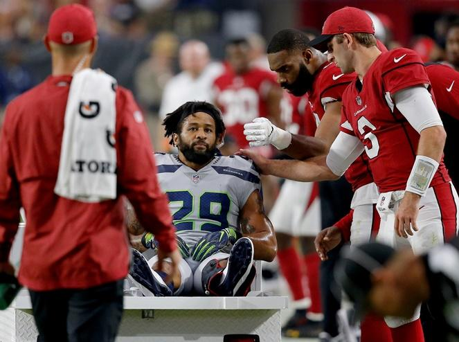 Seahawks defensive back Earl Thomas is greeted by Arizona Cardinals players as he leaves the field after breaking his leg during the second half of the game Sunday, Sept. 30, 2018, in Glendale, Ariz. The Seahawks won 20-17.