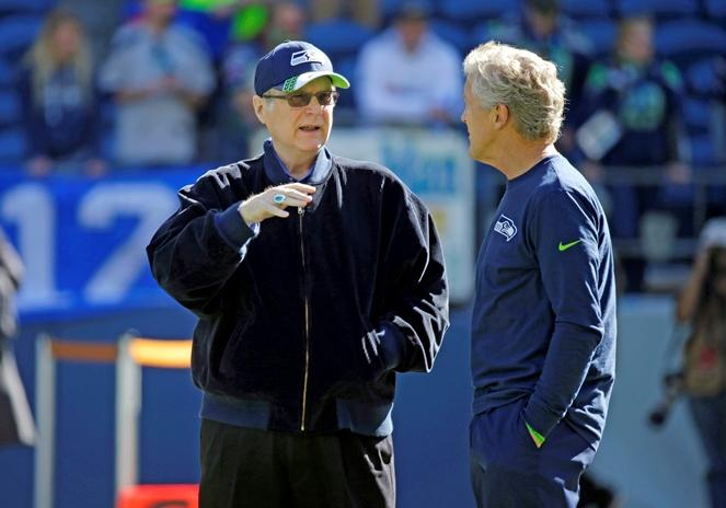 In this Sept. 27, 2015 file photo, Seattle Seahawks owner Paul Allen, left, talks with Seahawks head coach Pete Carroll before a game against the Chicago Bears in Seattle.