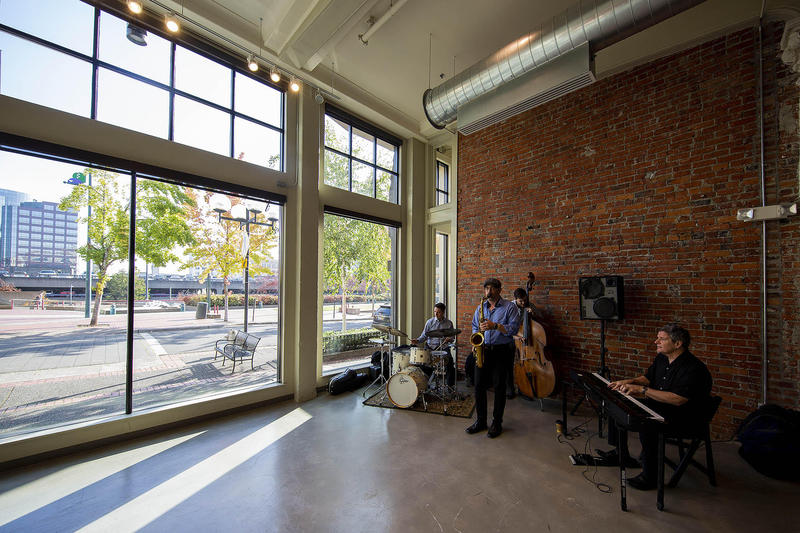 A jazz band performs in the space KNKX plans to occupy in downtown Tacoma
