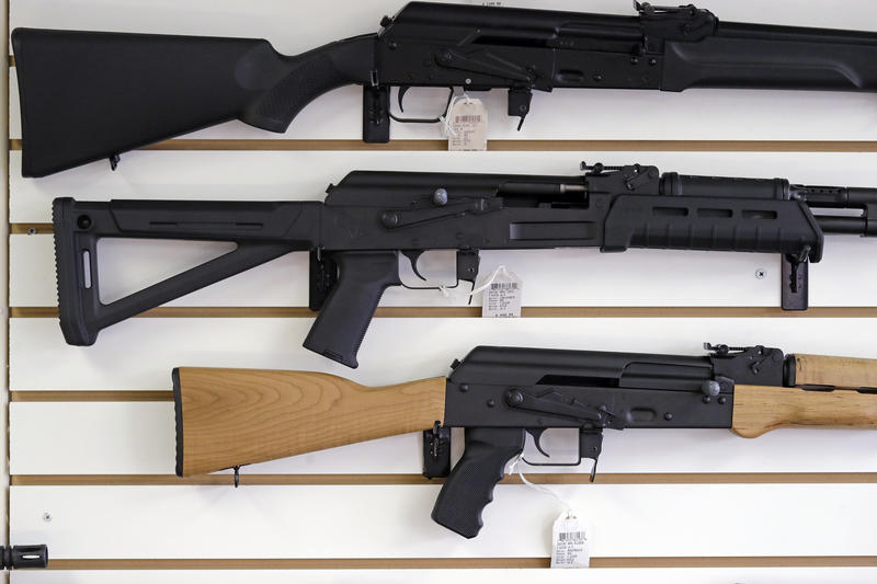 In this Oct. 2, 2018, file photo, semi-automatic rifles are displayed on a wall at a gun shop in Lynnwood, Wash. Voters will decide the fate of I-1639, an initiative that would toughen background checks for people buying semi-automatic rifles, increase th