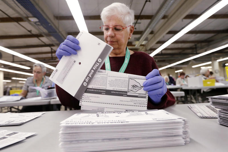 Election worker Diana Kaczor sorts ballots from security envelopes at the King County Elections office Monday, Nov. 5, 2018, in Renton, Wash.