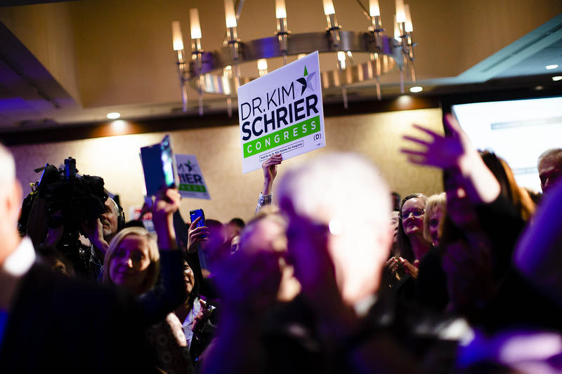 Supporters celebrate Kim Schrier's early lead over Dino Rossi at the Democratic election-night party in Bellevue.