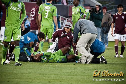 Sounders midfielder Steve Zakuani writhes in pain after a tackle by Rapids midfielder Brian Mullan in April 2011 in Denver. Zakuani is still recovering from the injury as Mullan and the Rapids make their first trip to Seattle since the hit on Saturday.