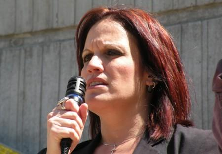 Former Amazon warehouse worker, Karen Salasky, addresses protesters at Amazon headquarters.