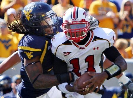 Bringing his sack to Seattle: West Virginia's Bruce Irvin, left, sacks Maryland quaterback Jamarr Robinson in Sept. 2010.